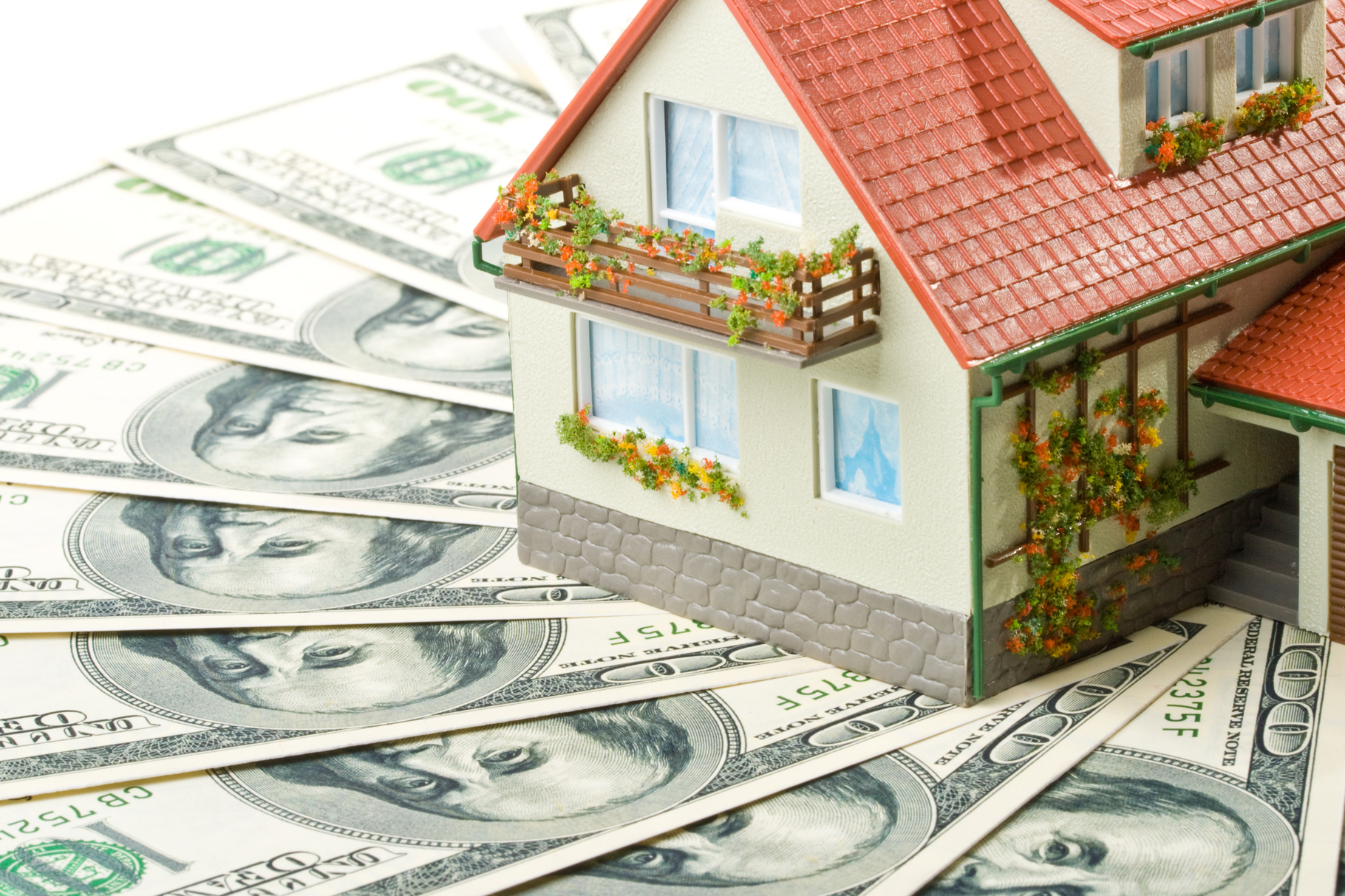 Miniature House and Money. Buying house concept